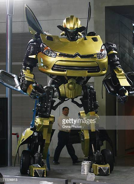 A passerby views the 'Transformer X2' built by Chinese cartoon fans Sui Lulu Zhang Yiming and Li Wei to be displayed at an exhibition center on...