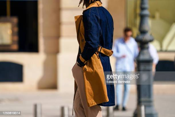 A passerby wears a blue and brown denim coat beige pants on June 28 2020 in Paris France