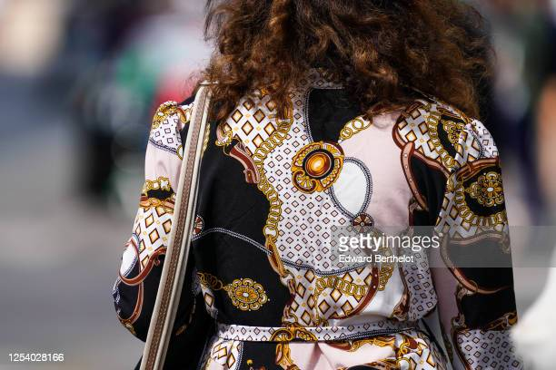 A passerby wears a dress with printed patterns on June 28 2020 in Paris France
