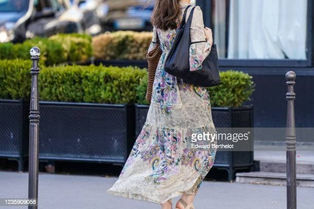 A passerby wears a floral print dress on May 30 2020 in Paris France