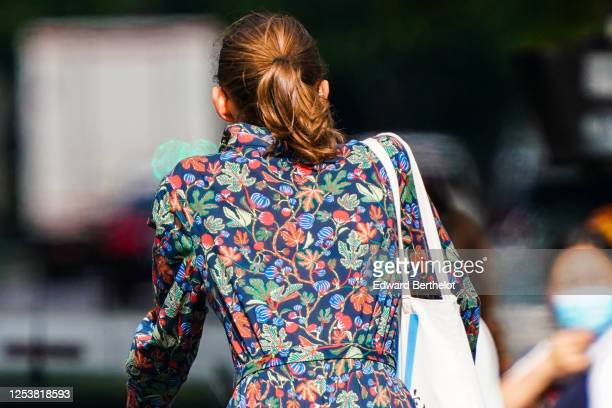 A passerby wears a multicolor floral print dress on June 28 2020 in Paris France