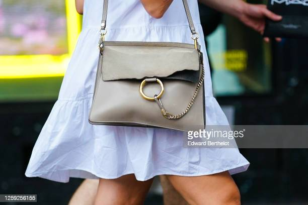 A passerby wears a white dress a Chloe bag on July 25 2020 in Paris France