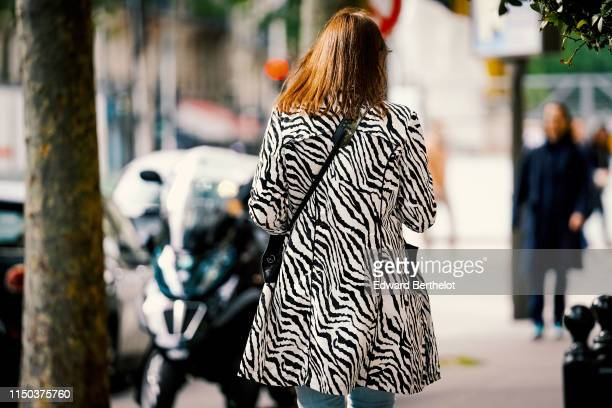 A passerby wears a zebra print striped jacket in Paris on May 18 2019 in Paris France
