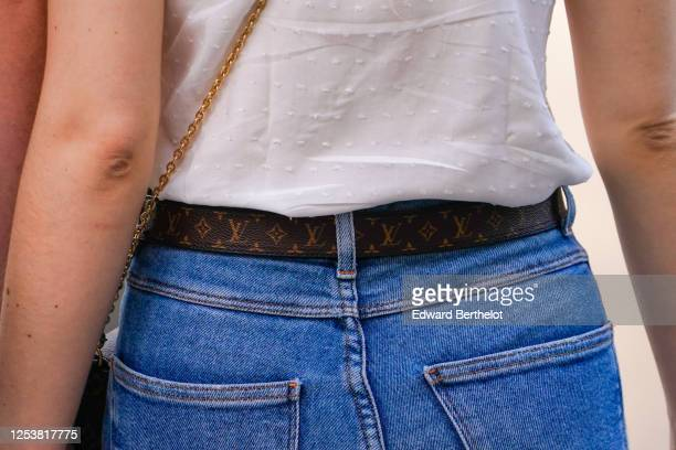 A passerby wears brown leather Louis Vuitton monogram belt on June 28 2020 in Paris France