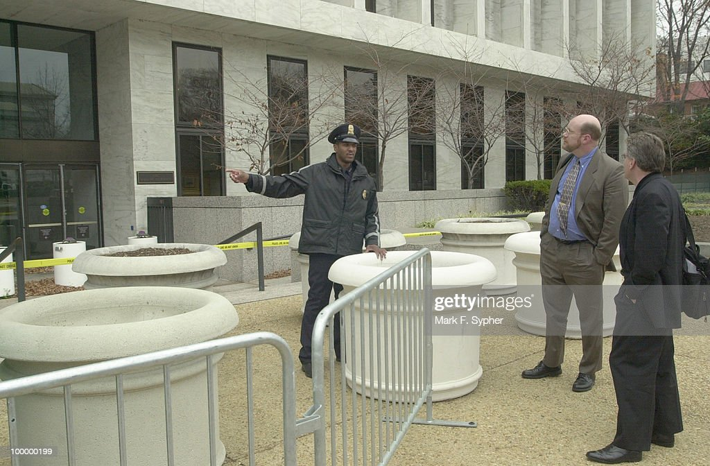Passers by question a U.S. Capitol Policeman as to when the Hart building will re-open. 'All the time' when asked how often he gets the question.