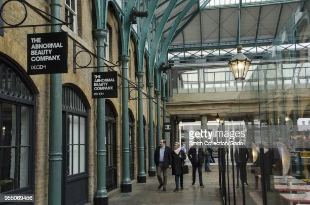 Passers in front of the Deciem abnormal beauty company at the north hall of the New Covent Garden Market Nine Elms London United Kingdom October 29...