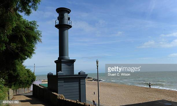 Passersby admire an art installation by Pablo Bronstein displayed as part of the Folkestone Triennial Public Art Project on August 28 2014 in...