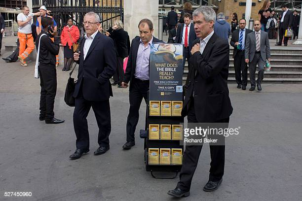Passersby and a mobile rack of Jehova's Witness pamphlets outside Liverpool Street station City of London Such racks seem to be everywhere around the...