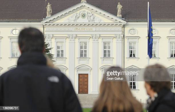 Passersby look at Schloss Bellevue presidential palace on January 4 2012 in Berlin Germany German President Christian Wulff is coming under...
