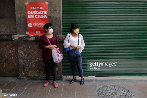 Passersby observe musicians of the grupero and cumbia genre who marched in the streets of the Historic Center to demand support during the health...