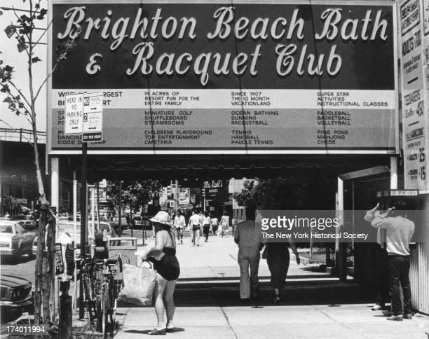 Passersby outside the Brighton Beach Bath and Racquet Club Brooklyn New York New York 1985