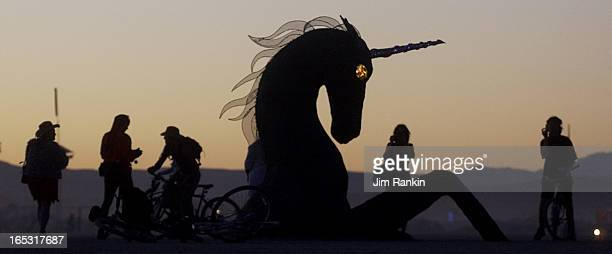 DESERT NV Passersby stop to admire Twilight Anima Rising one of over 150 works of art dotting the Black Rock Desert during Burning Man a weeklong...