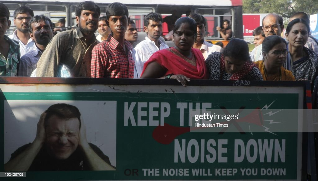 Passersby stop to see one of the sites of dual bomb blast on February 23, 2013 in Hyderabad, India. The dual blast which occurred on Thursday, reportedly killed 16 people.