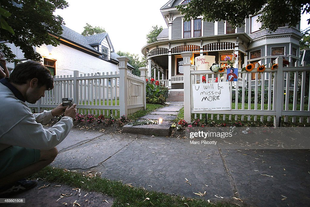 Passersby take in the makeshift memorial for Robin Williams on August 11, 2014 in Boulder, Colorado. The exterior of the house was used in the opening credits for 'Mork & Mindy,' the comedy based in Boulder that catapulted Williams' career. Williams, 63, died at his Northern California home Monday in a suspected suicide, according to law enforcement officials.