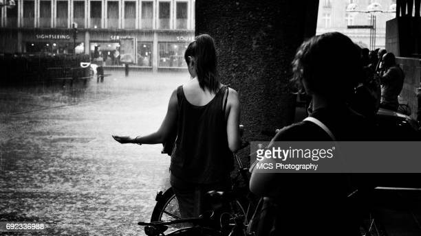 Passersby take shelter from cloudburst at Downtown Cologne