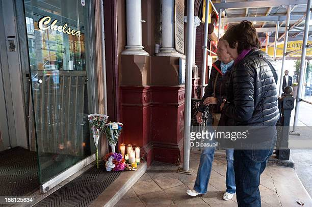 Passersby view a makeshift memorial for Lou Reed at the Hotel Chelsea on October 28, 2013 in New York City. Lou Reed died at his home in East...