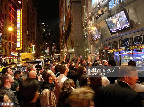 Passersby wait for results outside CNN election headquarters in New York's Times Square during the US presidential election 02 November 2004...
