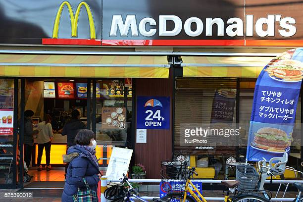 Passersby walk past a McDonald's store in Tokyo January 11, 2015. Plastic found in McDonald's Japan chicken nuggets and human tooth in fries....