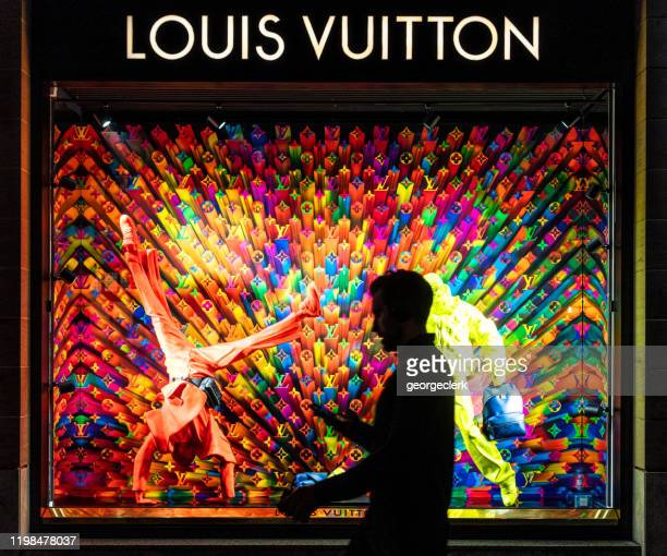 passing a louis vuitton display window - louis vuitton designer label stock pictures, royalty-free photos & images