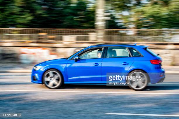 passing blue audi a3 - in the inner city of hamburg, germany - audi stock pictures, royalty-free photos & images