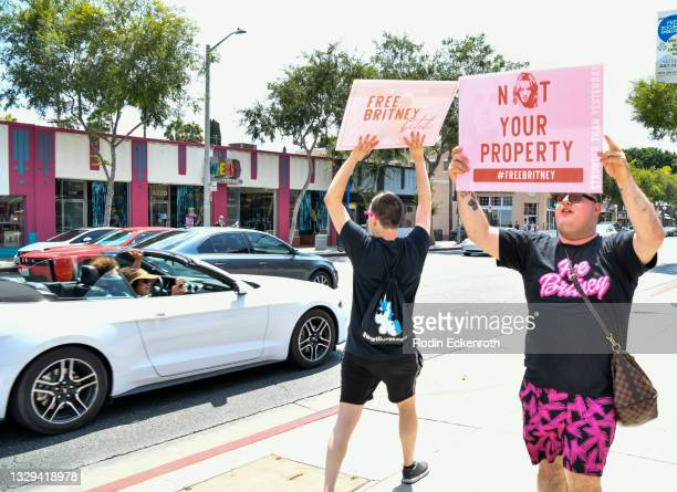 Passing cars honk and take pictures as protestors attend the #FreeBritney March starting in Plummer Park on July 18, 2021 in West Hollywood,...