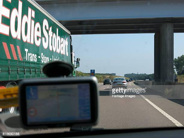 Passing Eddie Stobart truck on the A46 with satnav screen on windscreen Artist