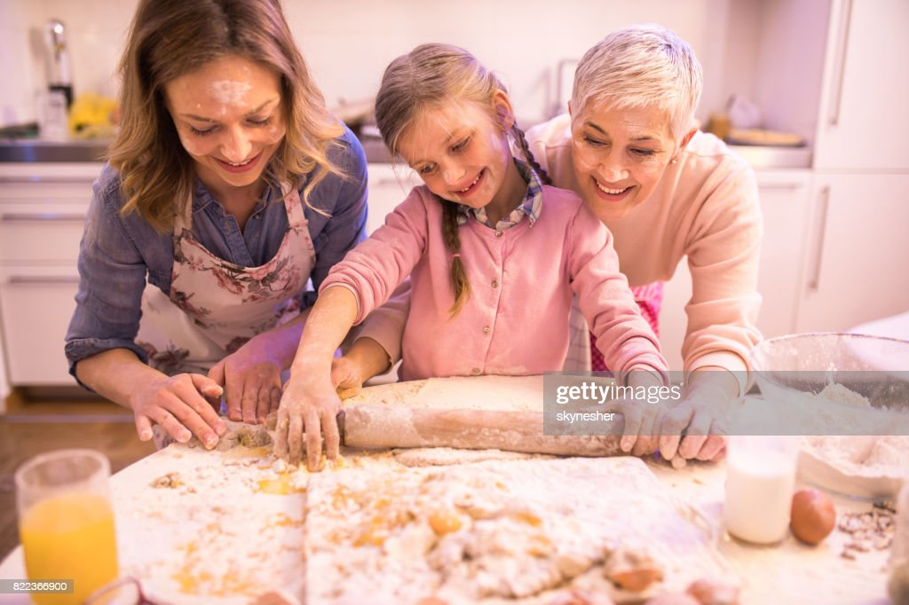 Passing family recipes to younger generations! : Stock Photo