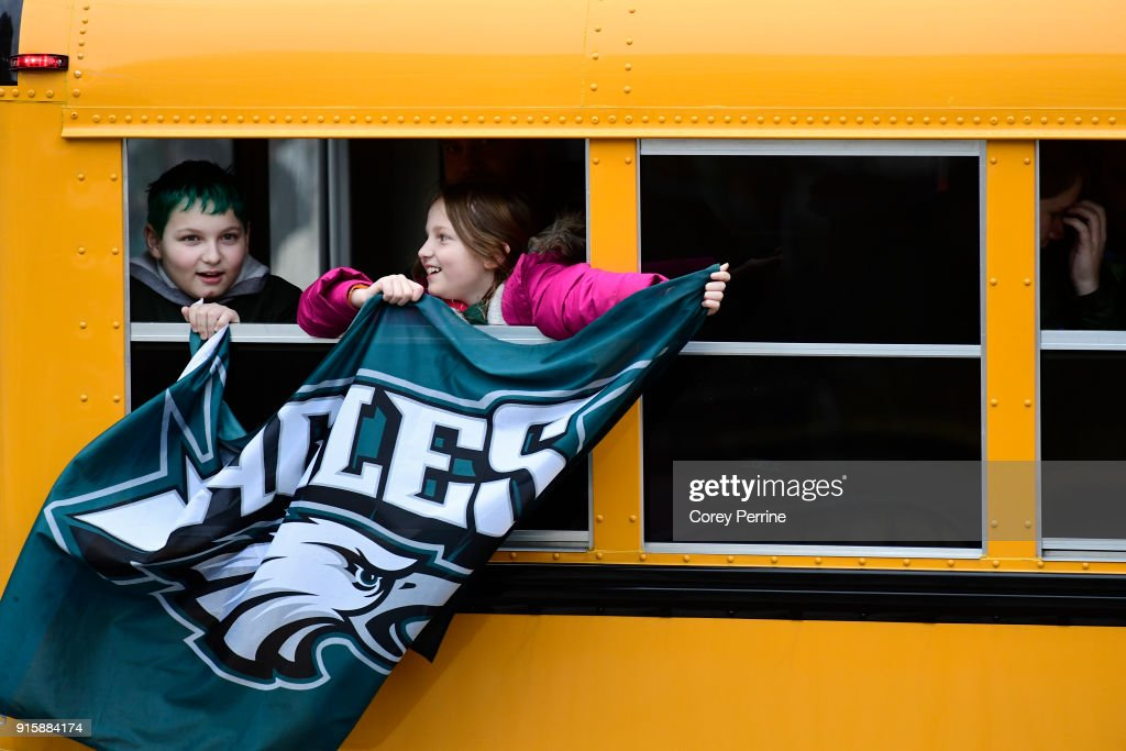 Passing fans fly an Eagles flag before festivities on February 8, 2018 in Philadelphia, Pennsylvania. The city celebrated the Philadelphia Eagles' Super Bowl LII championship with a victory parade.