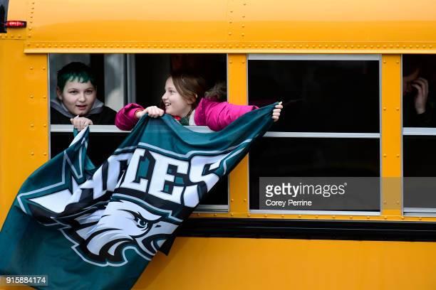 Passing fans fly an Eagles flag before festivities on February 8 2018 in Philadelphia Pennsylvania The city celebrated the Philadelphia Eagles' Super...