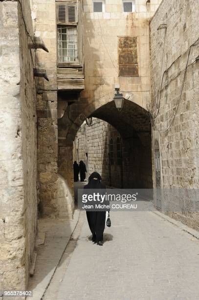 Passing in the narrow alleys around the souks of the old town of Aleppo House with wooden balcony of type Aleppo