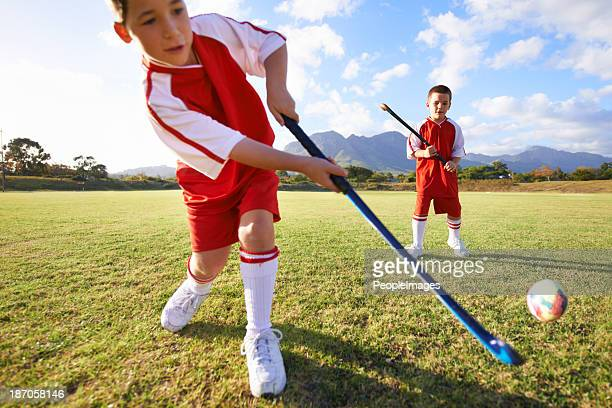 passing on the ball - field hockey stock pictures, royalty-free photos & images