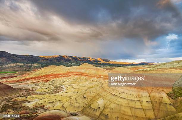Passing storm at sunset Painted Hill Unit of John Day Fossil Beds National Monument, Oregon, USA