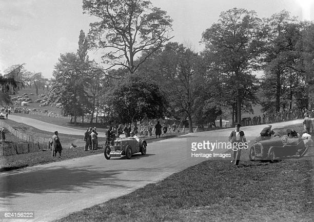 MG J2 passing the crashed Austin 7 of B Sparrow Donington Park Race Meeting Leicestershire 1933 Artist Bill BrunellMG J2 847 cc Vehicle Reg No AHX650...