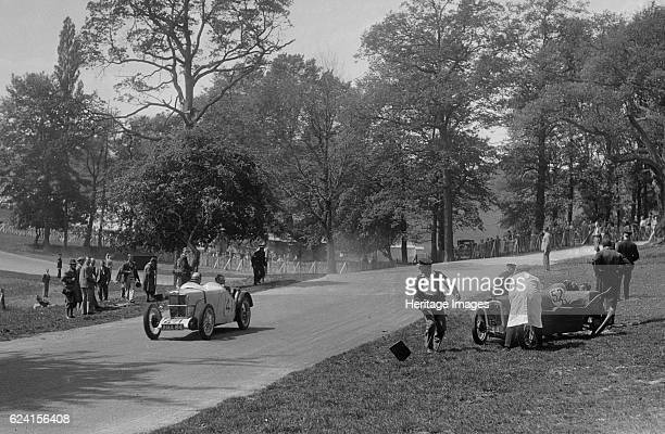 MG J2 passing the crashed Austin 7 of B Sparrow Donington Park Race Meeting Leicestershire 1933 Artist Bill BrunellLeft MG J2 847 cc Reg No AMA84...