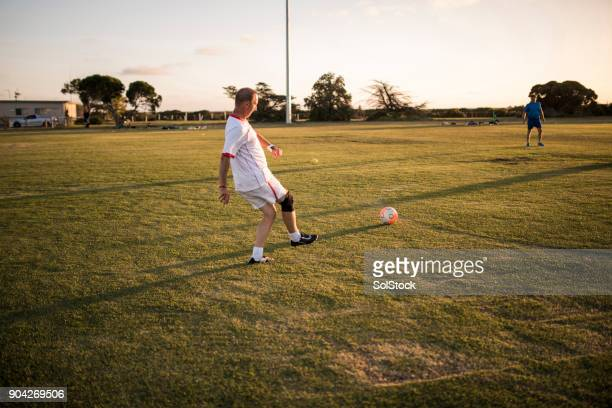 passing the football - passing sport stock pictures, royalty-free photos & images