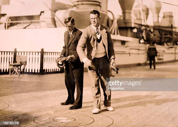 Passing the time during the long journey to Australia England cricketers Eddie Paynter and Tom Mitchell on board the RMS Orontes circa September 1932...