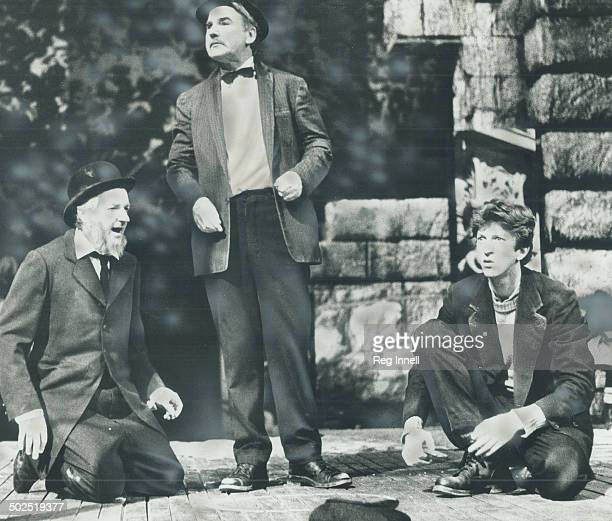 Passing the time while rebellion boils in Dublin tenement dwellers played by James B Douglas Gerrard Parkes and R H Thompson indulge themselves in...