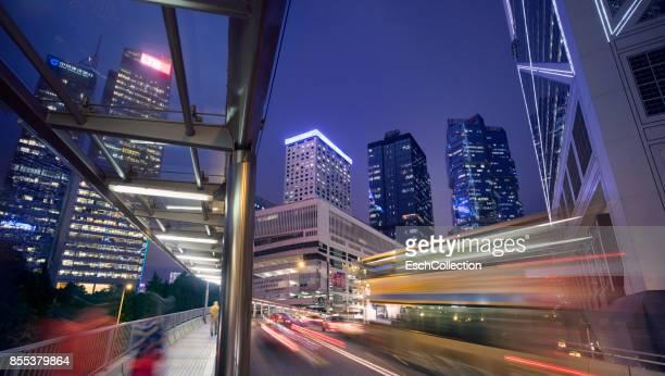 Passing traffic at Central District of Hong Kong at dusk