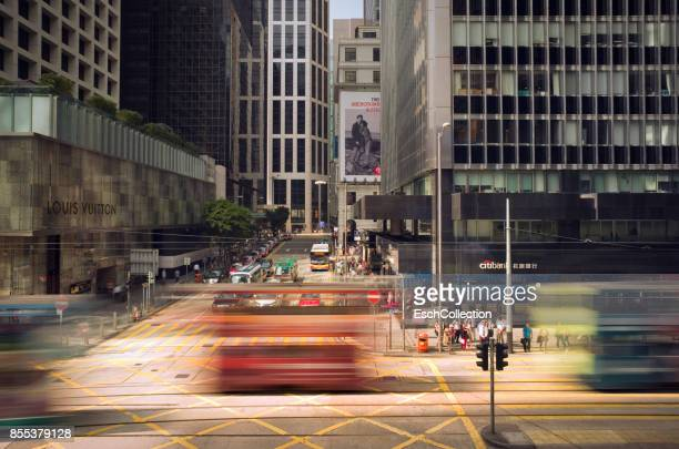 Passing trams at busy junction in Central District of Hong Kong
