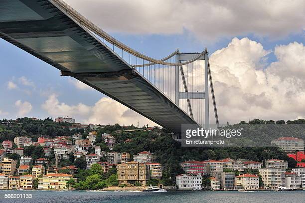 passing under fatih sultan mehmed bridge - emreturanphoto stock pictures, royalty-free photos & images