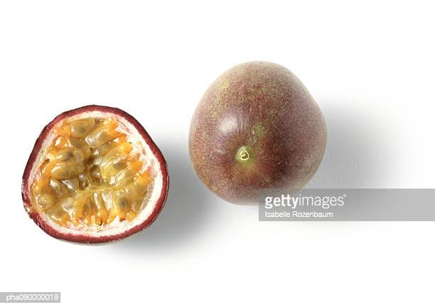 A passion fruit and a half, white background