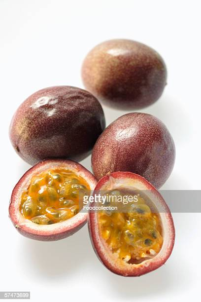 Passion fruits, one halved (Purple granadilla)