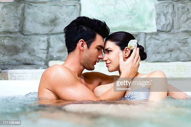 Passionate couple in jacuzzi at spa center