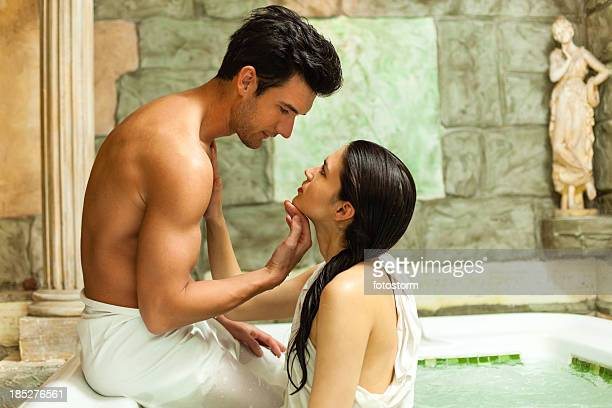 passionate couple in hot tub at spa center - couple bathtub stock pictures, royalty-free photos & images