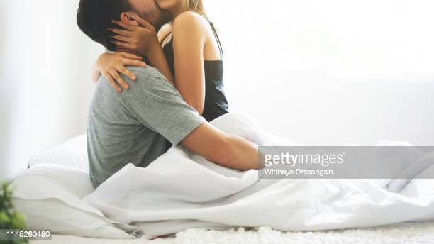 passionate couple is having sex on bed - sexual issues stock pictures, royalty-free photos & images