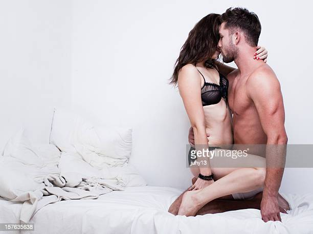 passionate couple on the bed - erotische stockfoto's en -beelden