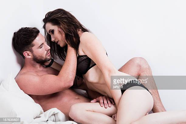 passionate couple on the bed - erotiek stockfoto's en -beelden