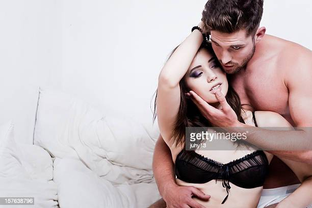 passionate couple on the bed - heterosexual couple photos stock photos and pictures