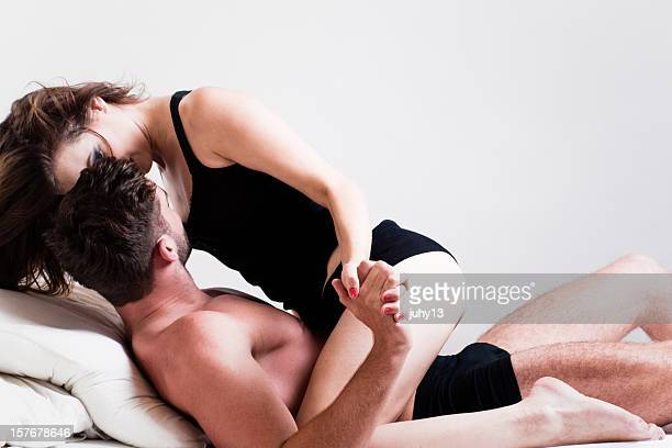 passionate couple on the bed - peck stock pictures, royalty-free photos & images