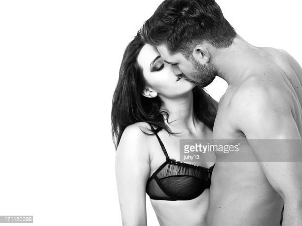 passionate couple on the bed - black and white sensual couples stock photos and pictures